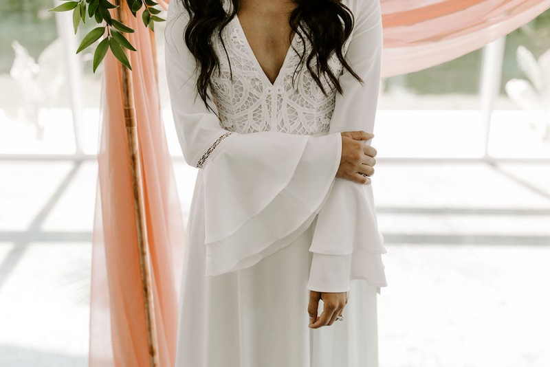 Bell sleeves on bride's wedding dress