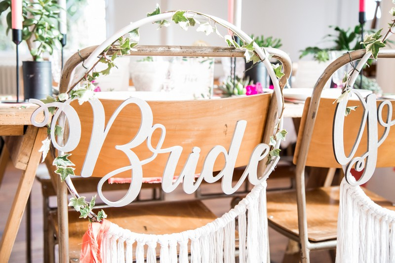 Bride dreamcatcher style hoop on back of wedding chair