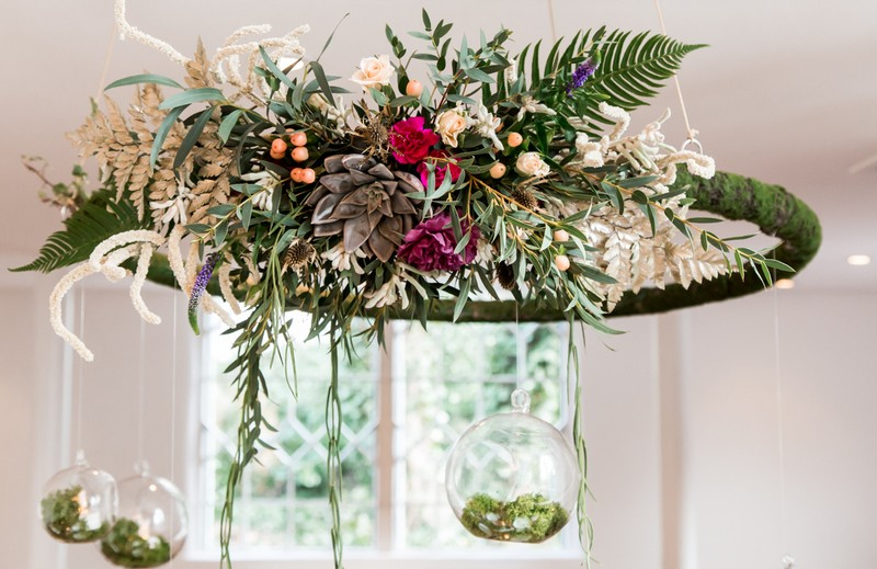 Foliage hoop hanging above wedding table