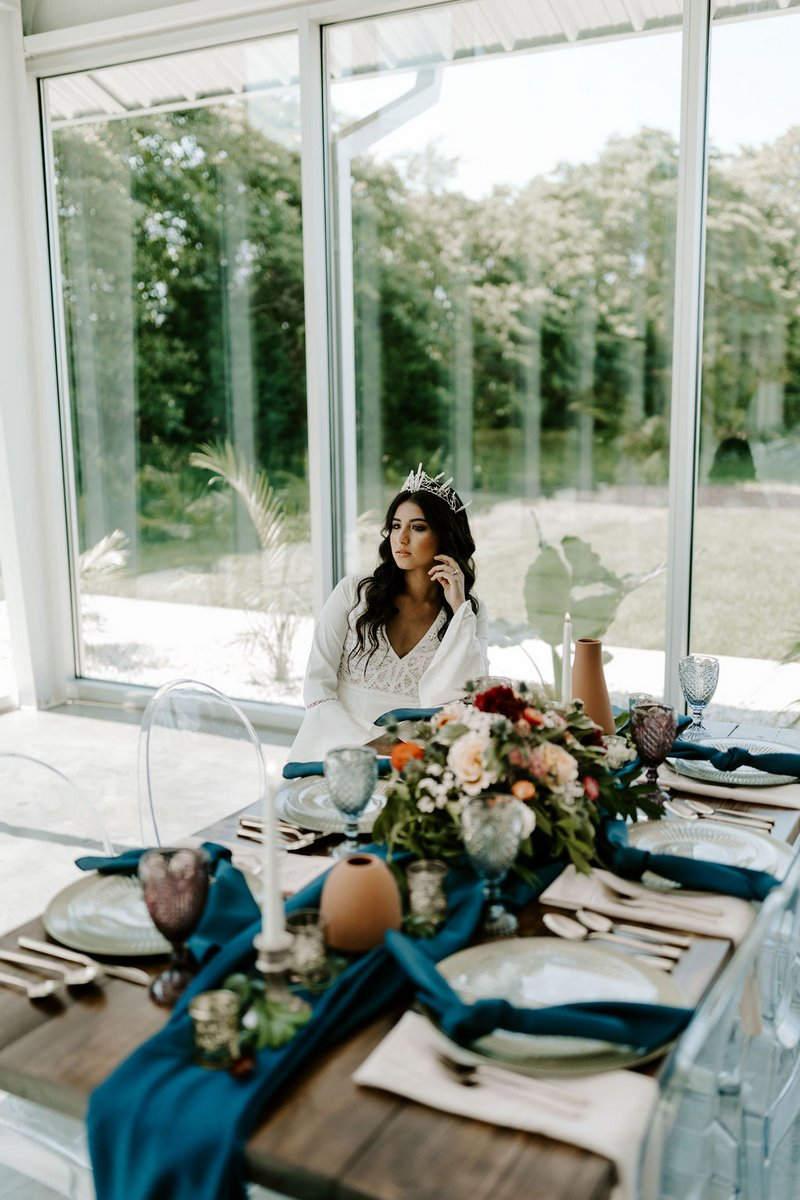Bride sitting at winter wedding table