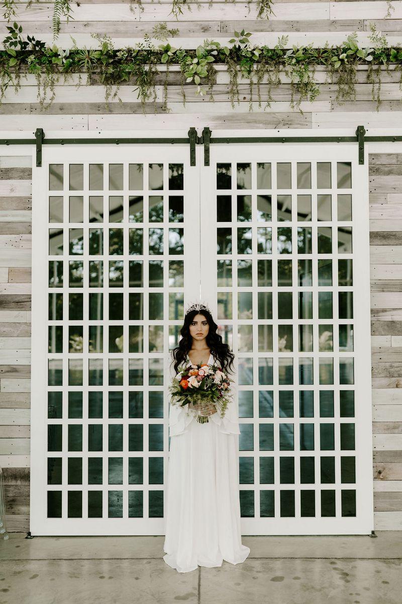 Bride standing in front of doors