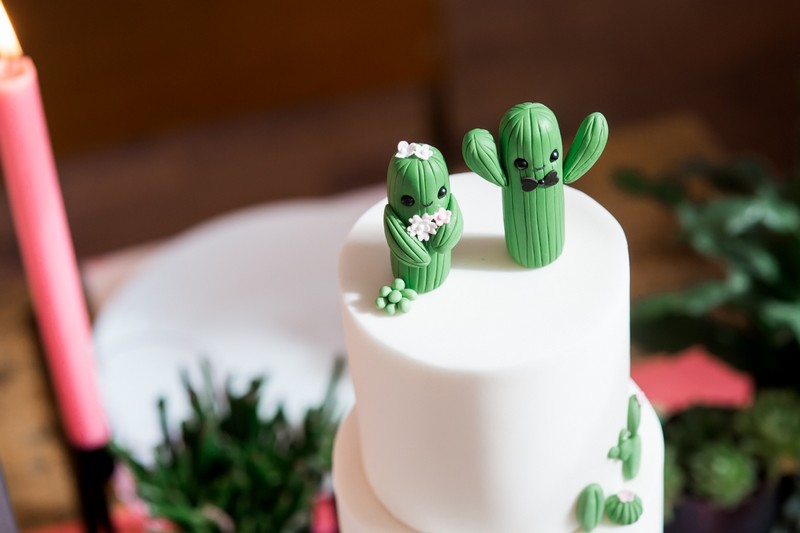 Bride and groom cactus wedding cake topper