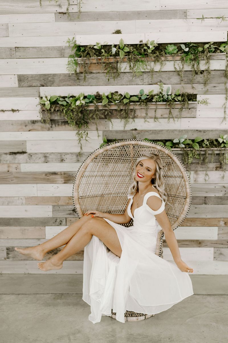 Bride sitting sideways on chair