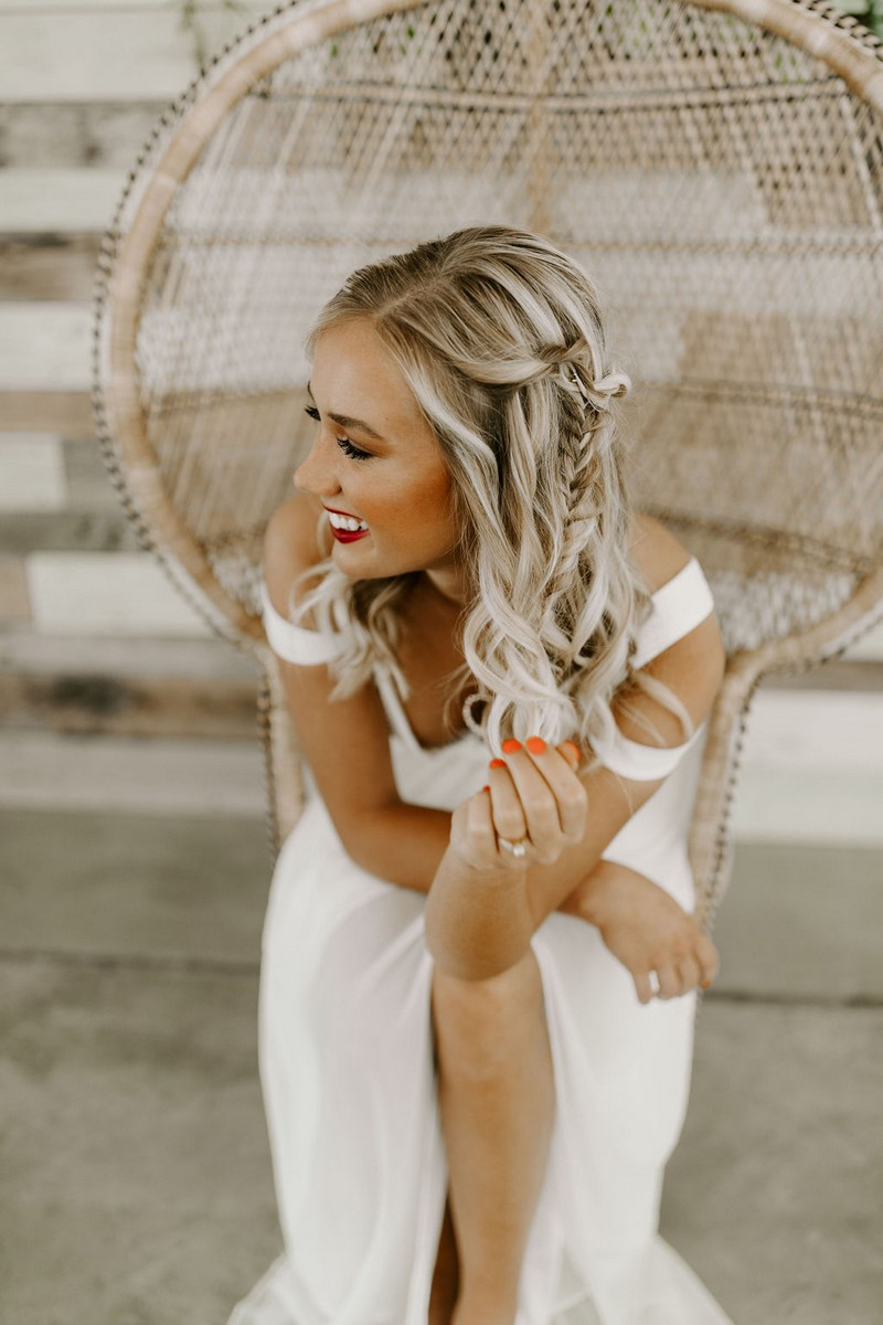 Bride leaning forward in chair