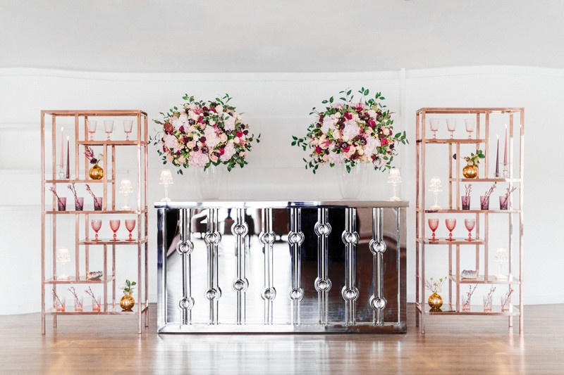 Engagement party bar with rose gold shelving