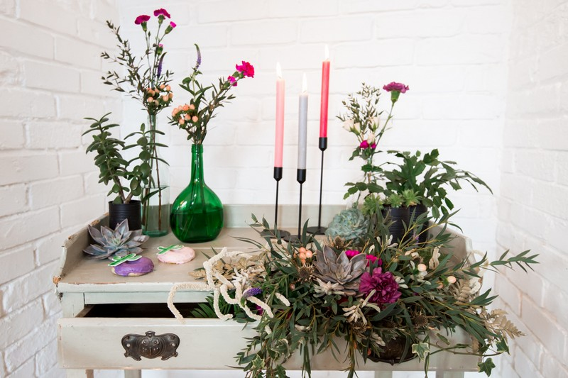 Dresser decorated with flowers and candles