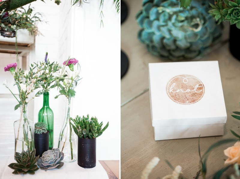Bottles and black tins of flowers with jewellery box