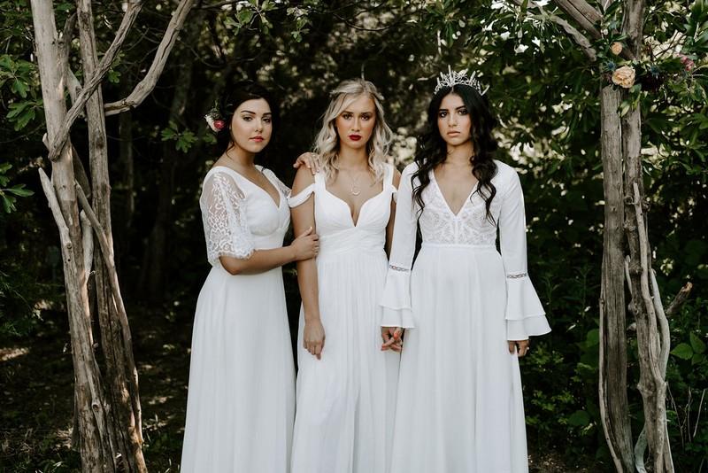 Three brides in white dresses