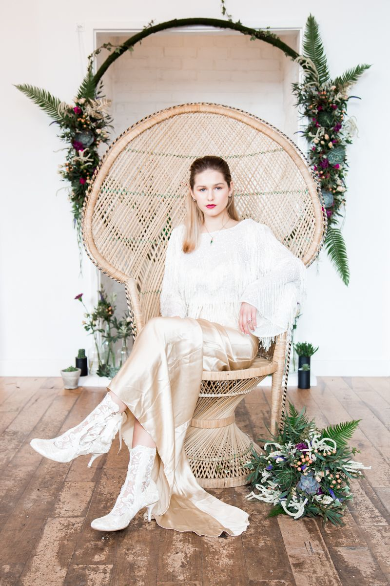 Bride sitting in vintage peacock chair