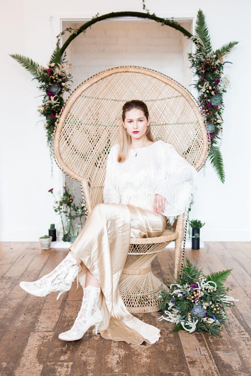 Bride sitting in vintage peacock chair