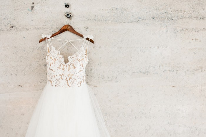 Wedding dress hanging on wall