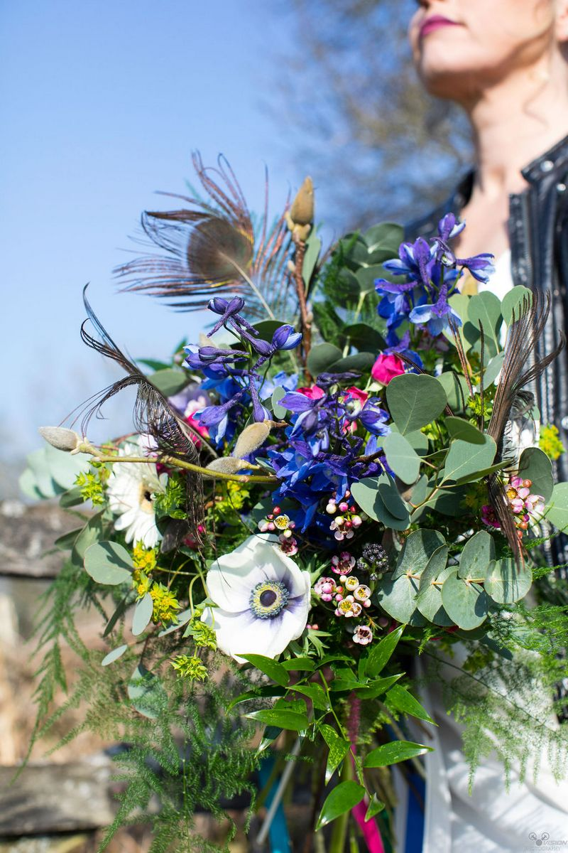 Rustic bridal bouquet with purple flowers