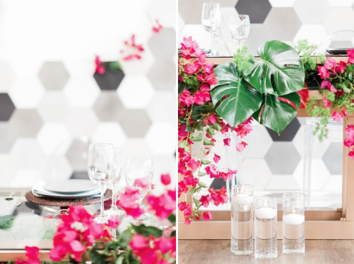 Glass vases with floating candles in front of wedding table styled with bougainvillea