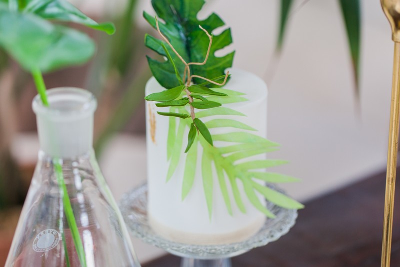 Palm leaf on small white wedding cake
