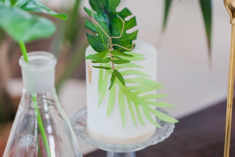 Palm leaf on small white wedding cake