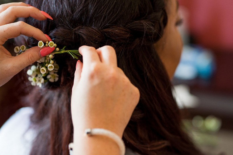 Flowers in bridesmaid's braid hairstyle