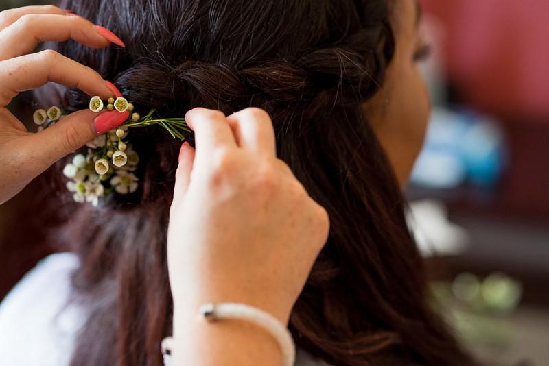 Flowers in bridesmaid's braid hairstyle