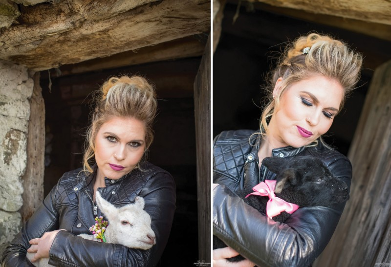 Bride in leather jacket holding baby goat