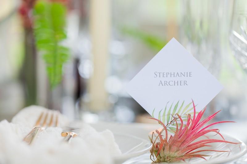 Elegant wedding name card with tropical leaf design