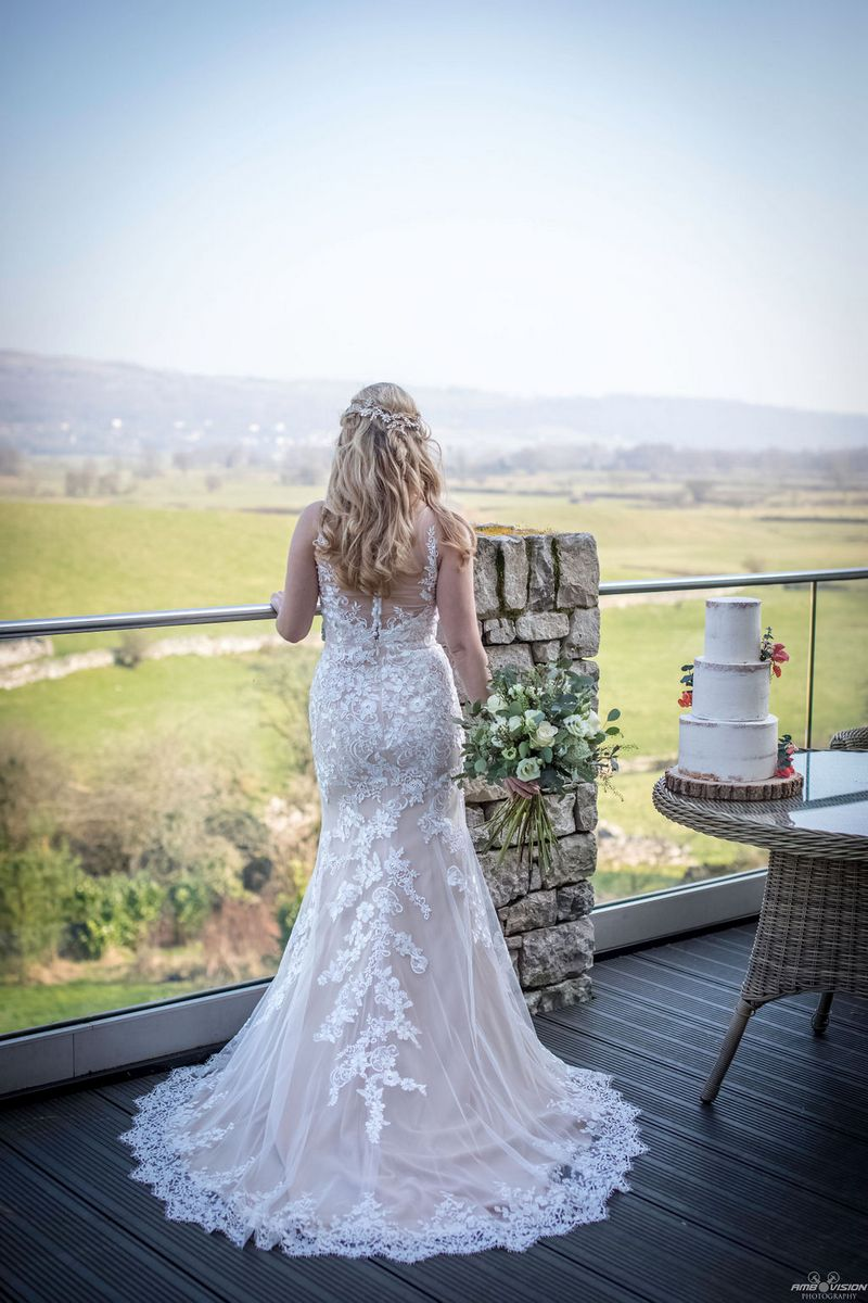 Bride looking out at countryside from Lyth Valley Country Inn
