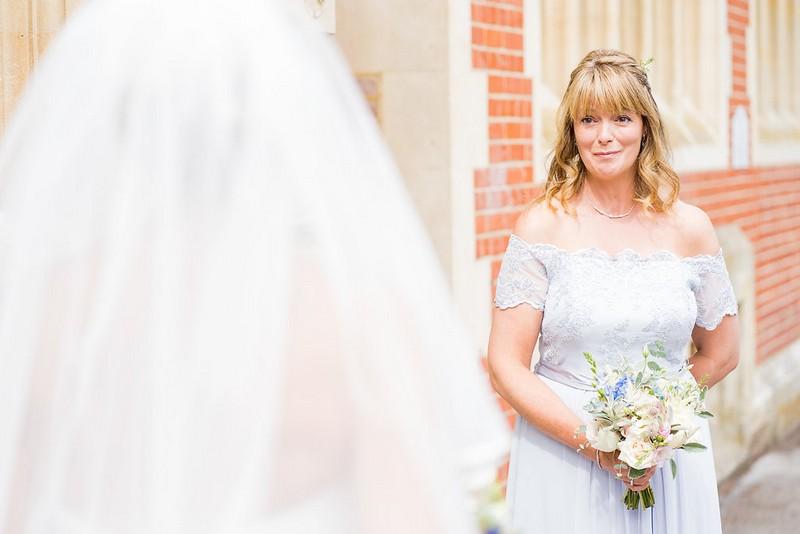 Bridesmaid emotional at seeing bride in wedding dress