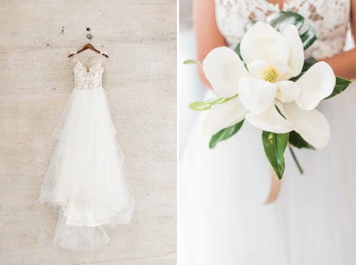 Wedding dress and bride holding bouquet of large white tropical flower