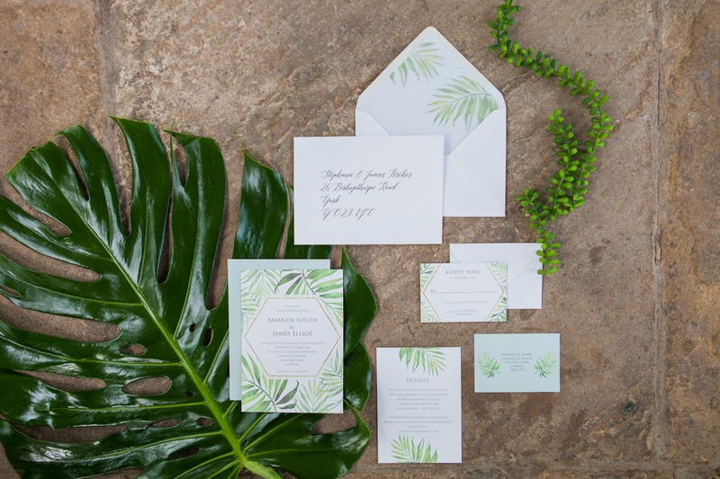 Wedding stationery with tropical palm leaf design
