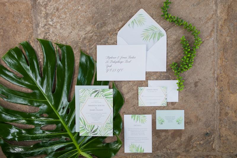 Wedding stationery with tropical palm leaf design