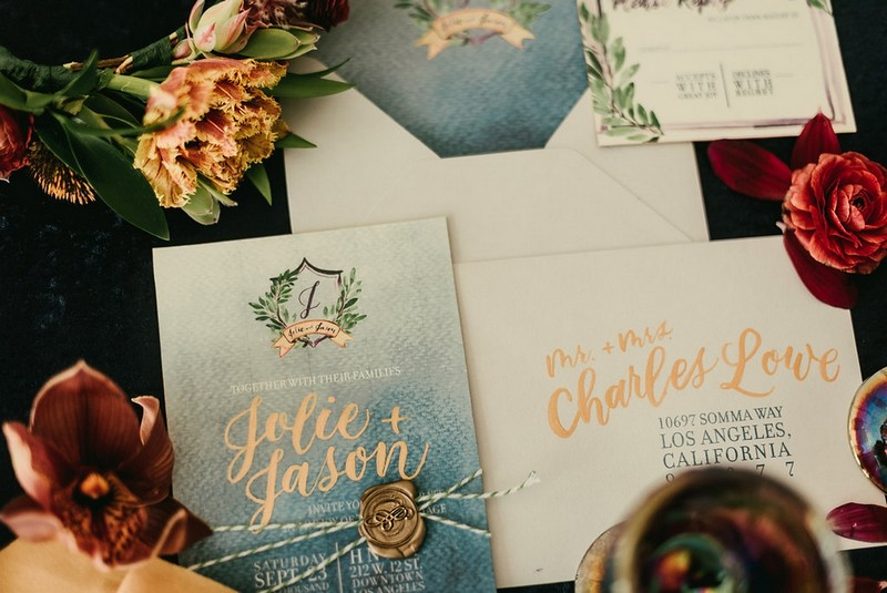 Blue and gold wedding stationery with foliage detail