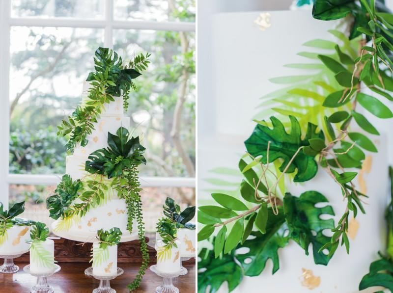 Palm leaf decoration on white wedding cake