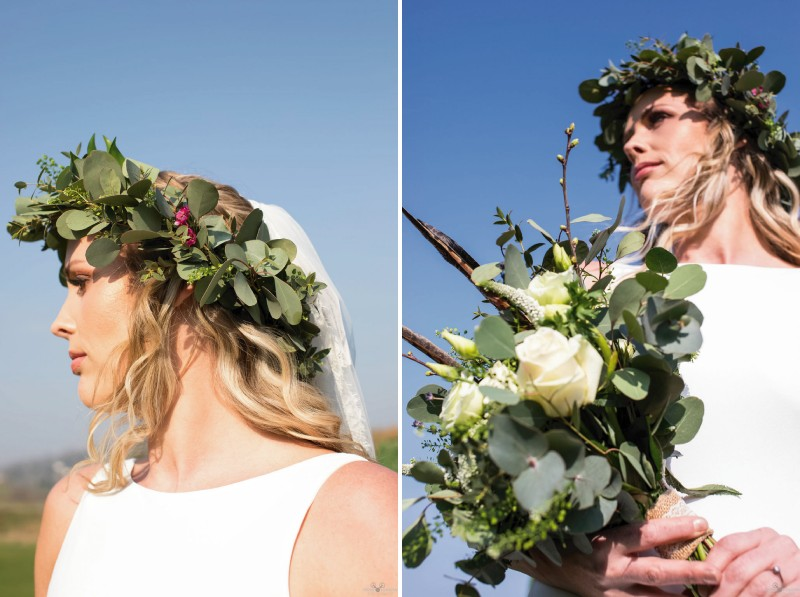 Bride with foliage crown holding bouquet with pheasant feathers