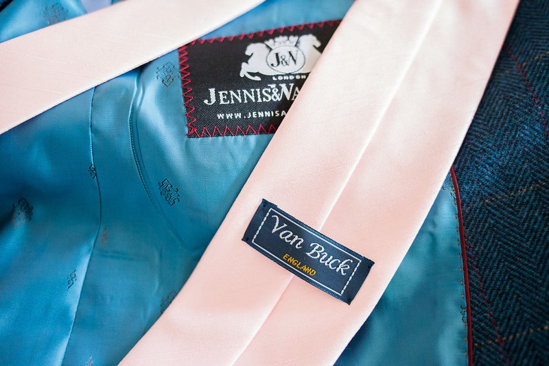 Blue suit jacket and pink tie