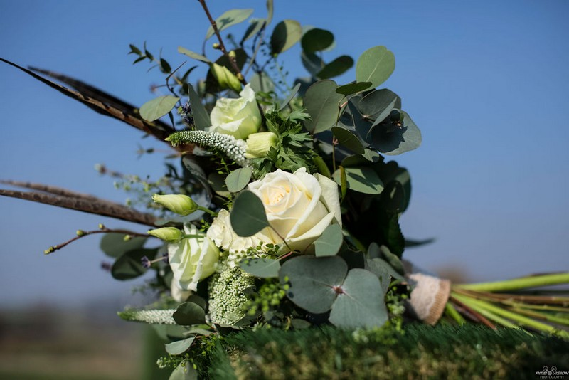 Wedding bouquet with white flowers and green foliage