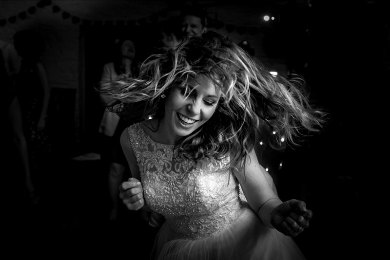 Close-up of bride dancing at wedding - Picture by Matt Badenoch Photography