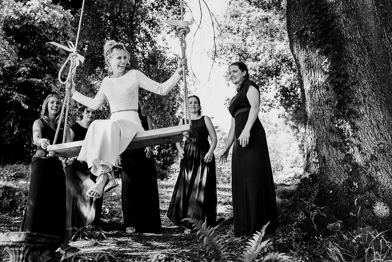 Bridesmaids pushing bride on tree rope swing - Picture by Lee Maxwell Photography
