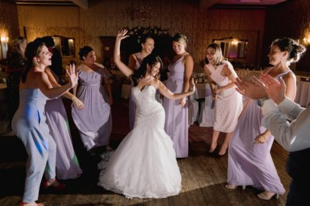 Bride and bridesmaids dancing at wedding - Picture by Murray Clarke
