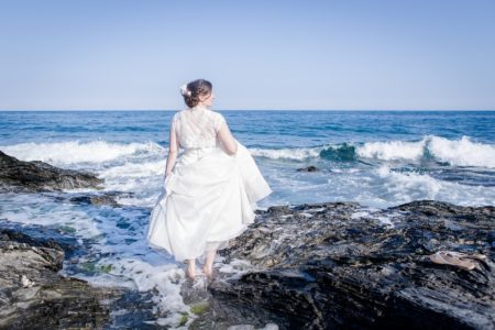 Bride paddling in the sea - Picture by Brian Robinson Photography