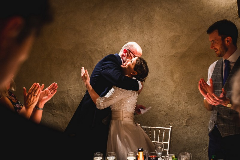 Father hugging bride after speech - Picture by How Photography