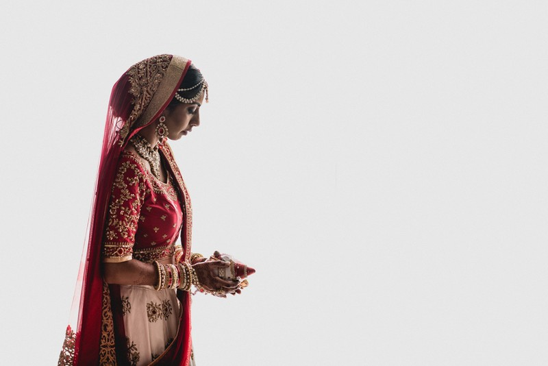 Indian bride holding decorated coconut - Picture by That Moment Photo