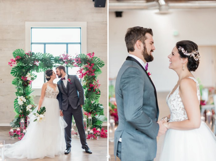 Bride and groom in front of tropical wedding ceremony arch