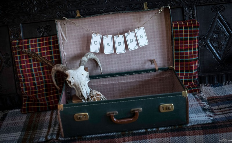 Old suitcase for wedding cards with animal skull