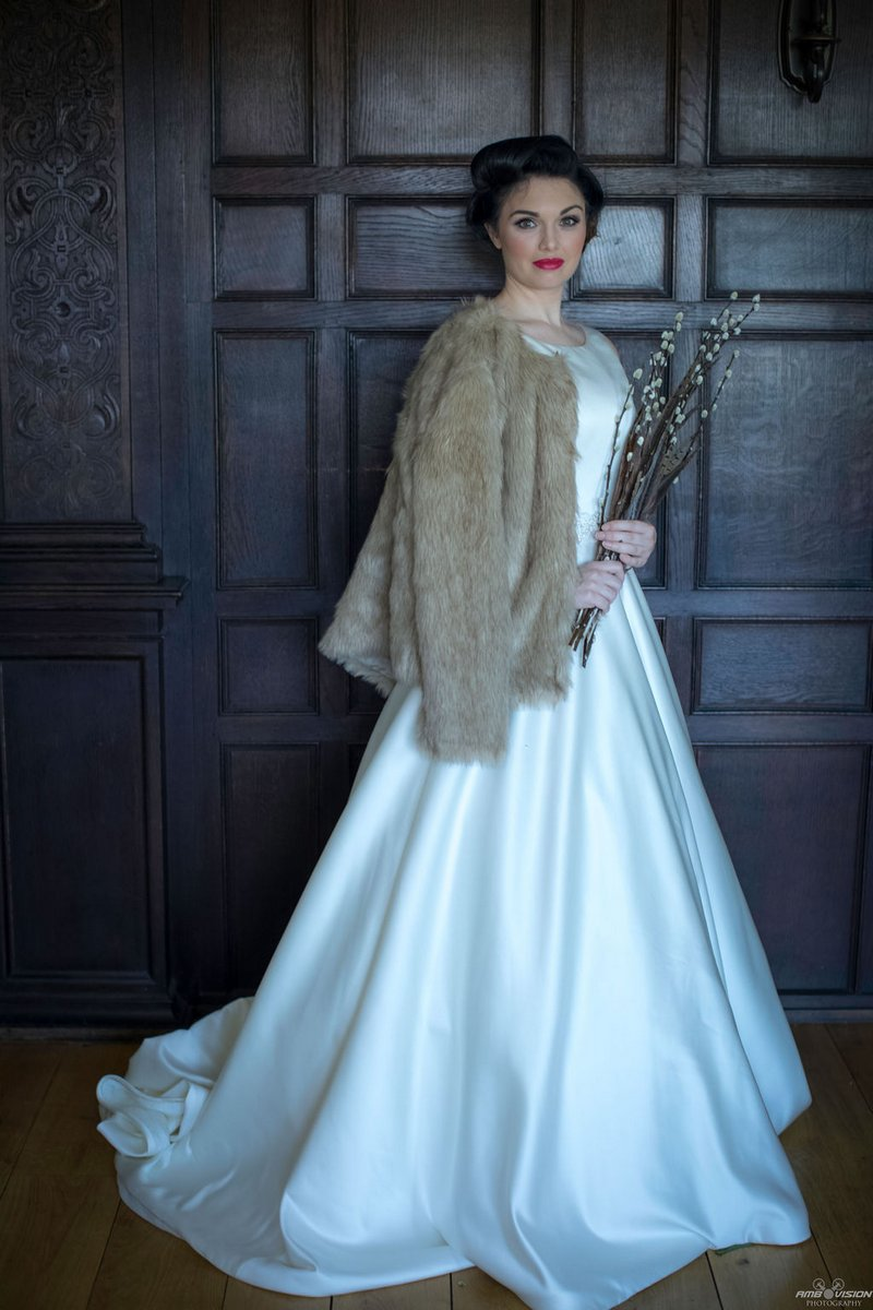 Bride with fur jacket over her shoulders
