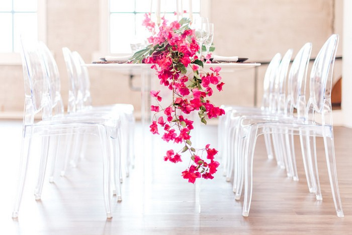 Bougainvillea hanging off of edge of wedding table