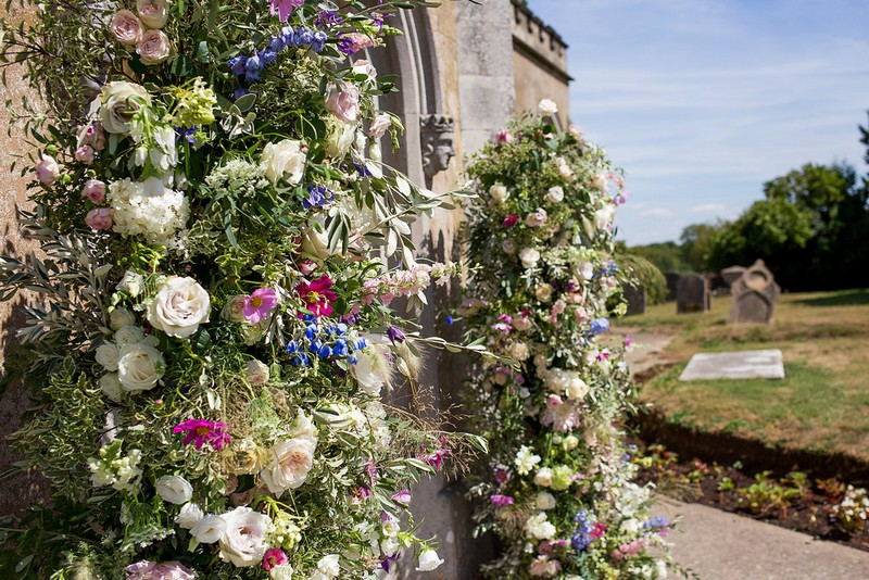Display of country flowers outside church