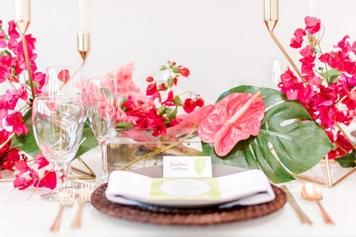 Wedding place setting with bright pink tropical wedding styling