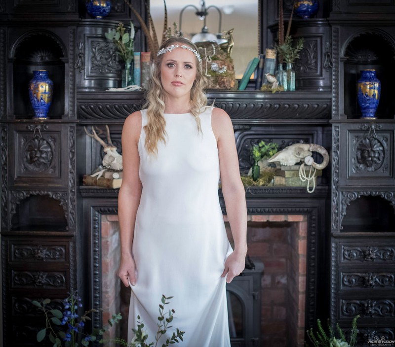 Bride standing in front of fireplace at Lyth Valley Country Inn