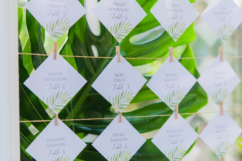 Escort cards with tropical leaf design