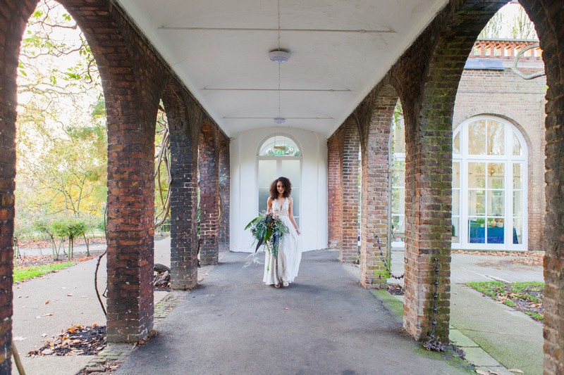 Bride in walkway at Holland Park