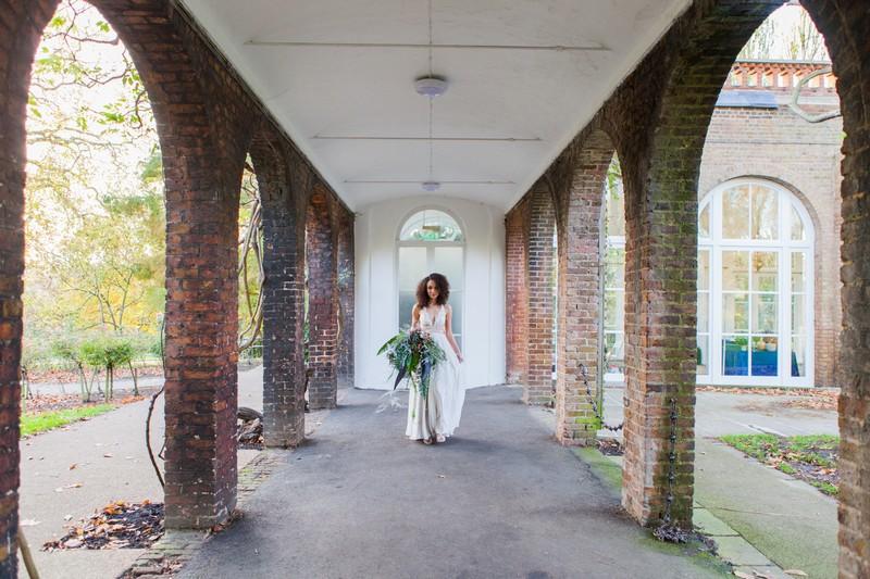 Bride in walkway at Holland Park