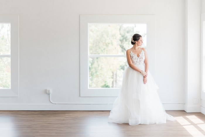 Bride standing in empty room